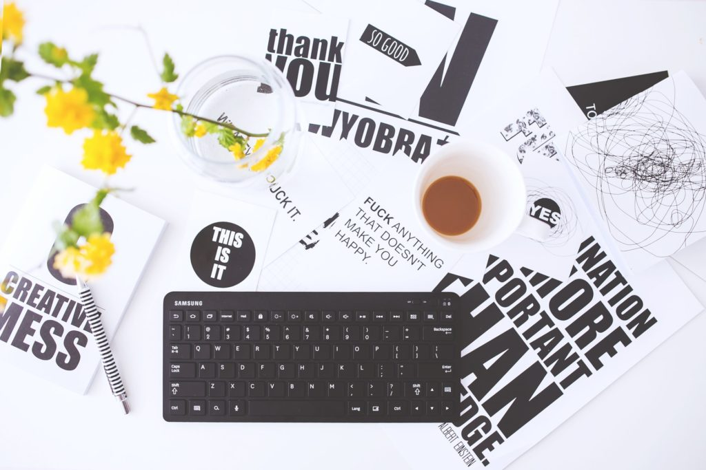 https://www.pexels.com/photo/top-view-of-creative-workspace-with-keyboard-and-coffee-6463/