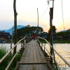 "The ""free"" bamboo bridge across Nam Xong river"