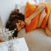 woman-curled-up-in-bed-3958603